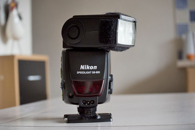 Use an external flashgun to bounce flash