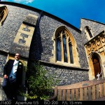 Groom against church wall